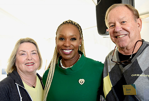 Photo: Ericka Warren '92, MBA '19, shares a moment with Dave and Nancy Petrone.