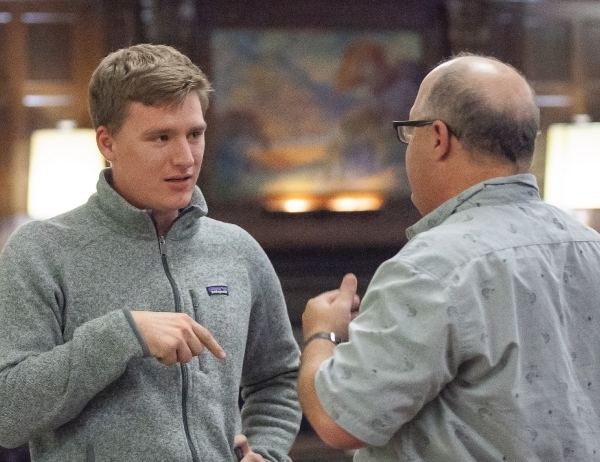 Student William Schoeffler speaks with another person