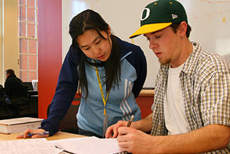 Business student receiving tutoring help