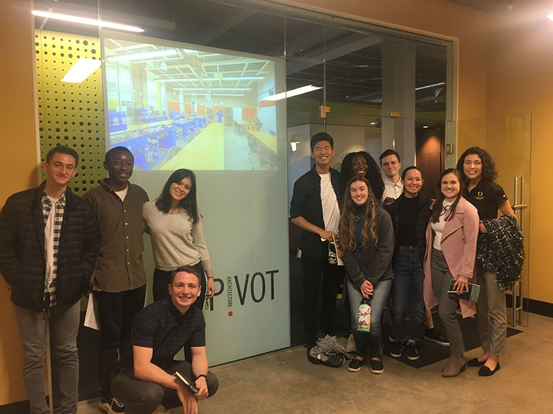 Members of the Net Impact group pose for a group photo in Pivot's headquarters