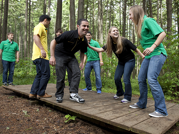 Photo: MAcc students work together to find balance at Spencer Butte Challenge Course