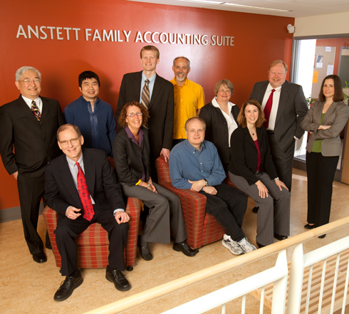 Group photo of faculty in the accounting department in front of the Anstett Accounting Suite