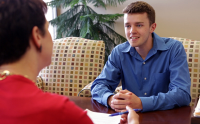 A job shadow student meets with a host employer