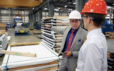 A student and host employer on the factory floor during a job shadow day