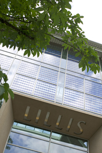 Photo of Lillis Complex Facade with Tree Branch