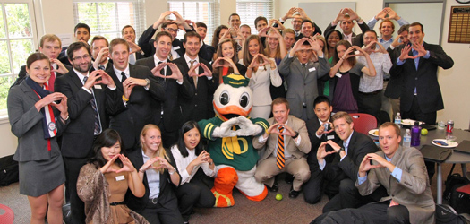Oregon MBA students celebrate with the Oregon Duck