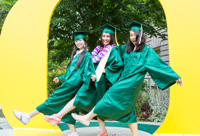 Undergraduate Students at UO Graduation in the middle of a big yellow O