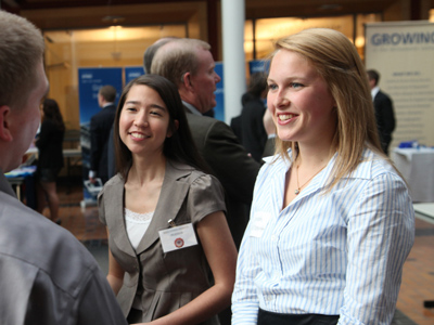 UO Business Students Networking with employers during a career event in the Lillis Business Complex