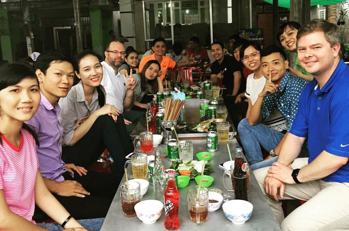 Sports Product Management interns at dinner in Vietnam