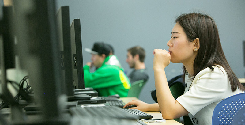 A student types on a computer in a lab