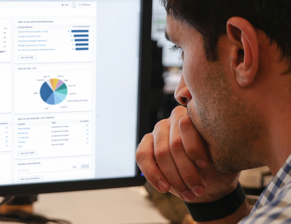 Close up of a PitchBook user accessing the program on their computer screen