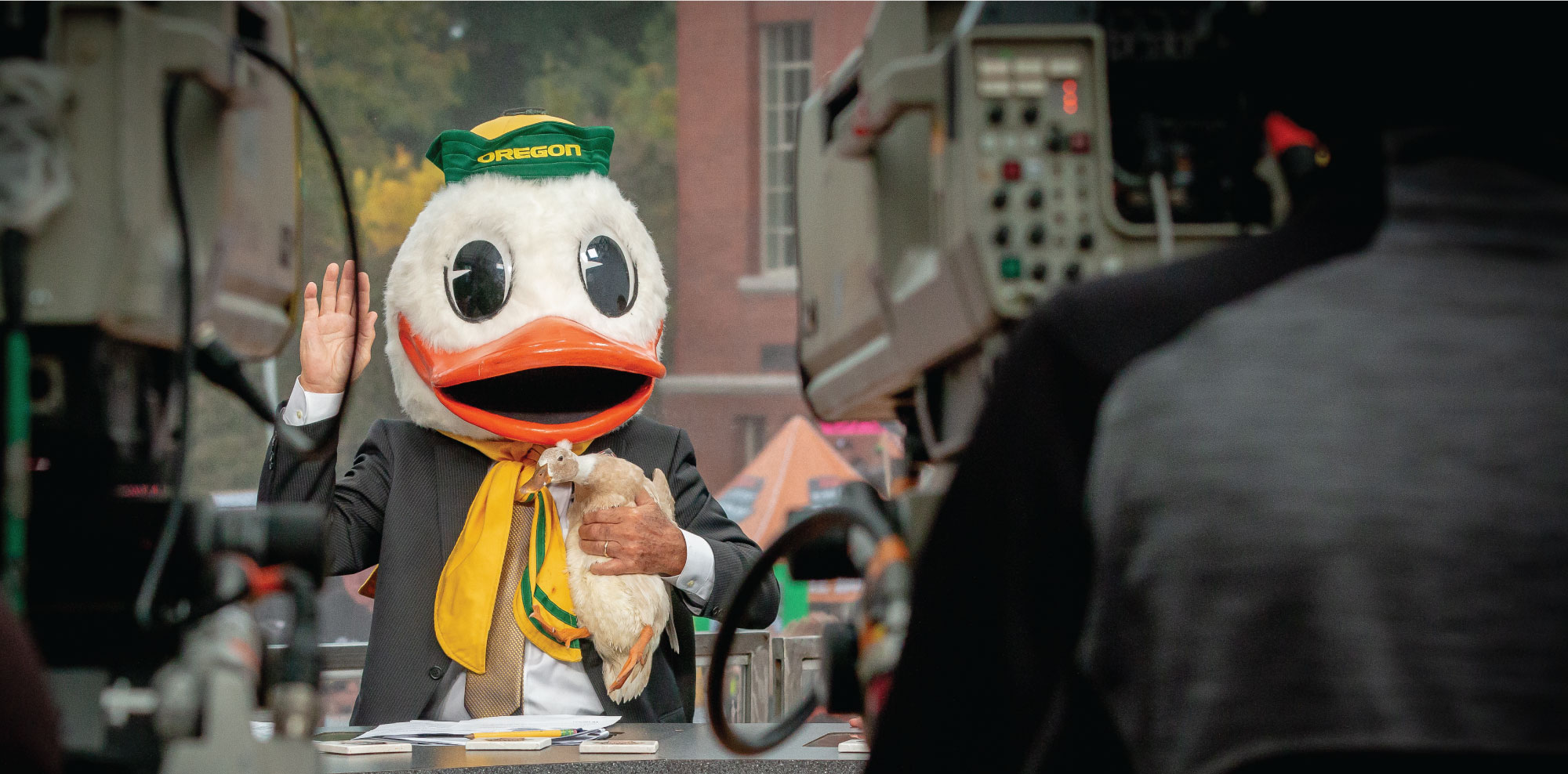 Lee Corso wears the Duck's mascot head during College GameDay