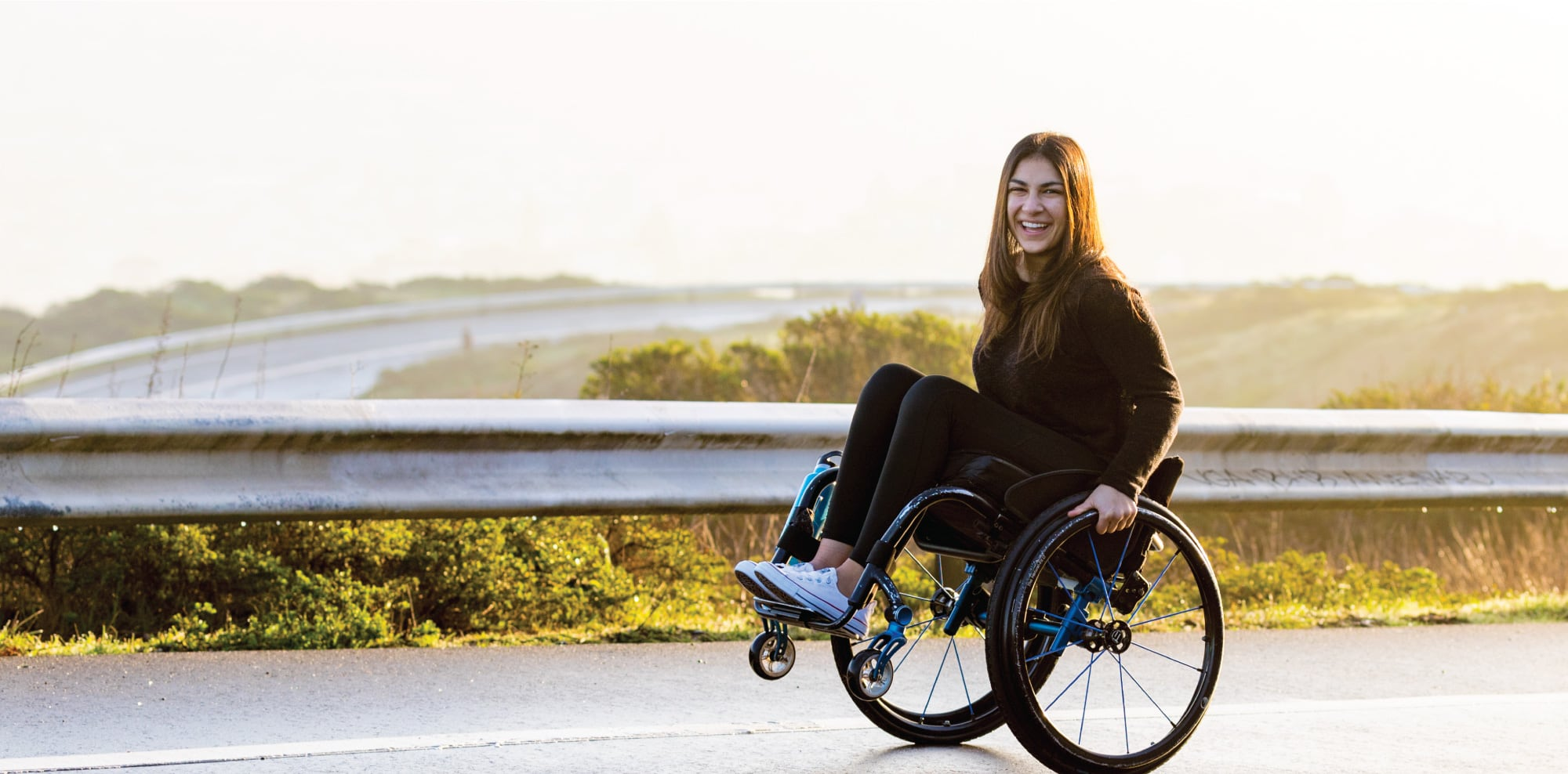 Alysia Kezerian at a scenic overlook in her wheelchair