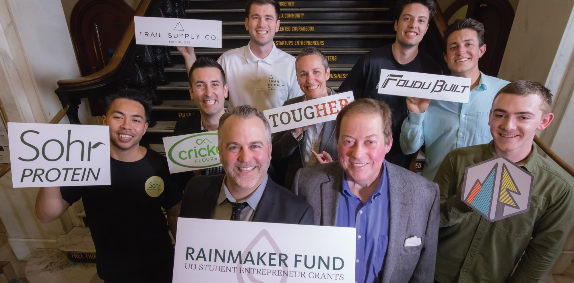 Paul Anthony Troiano poses for a photo with the student startup founders he's helped