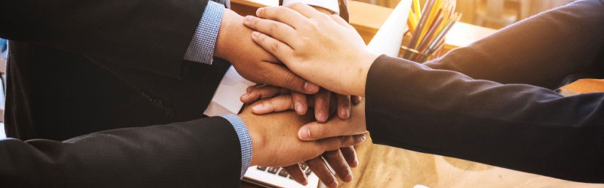 People in business suits join hands