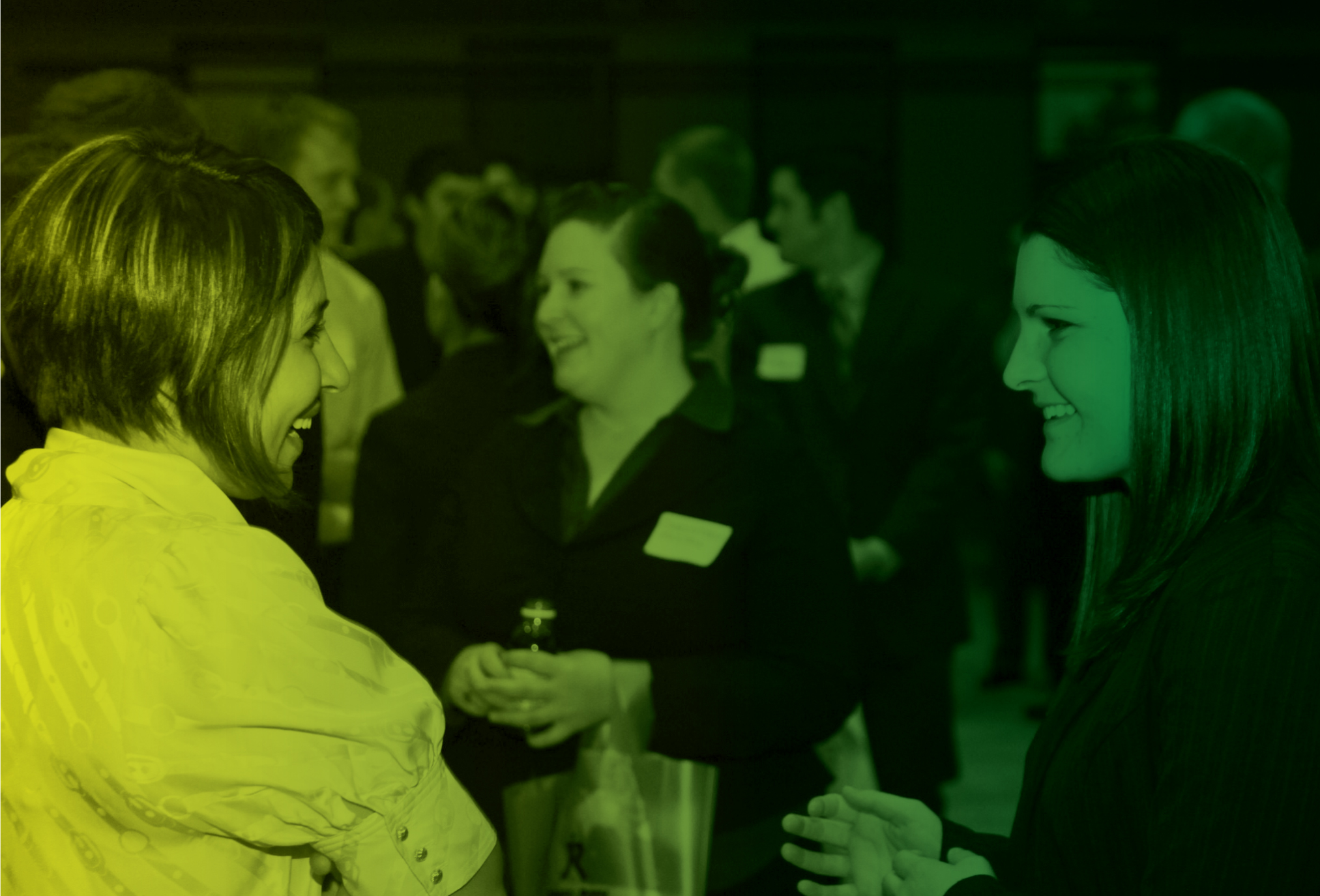 Two students chat during a networking event