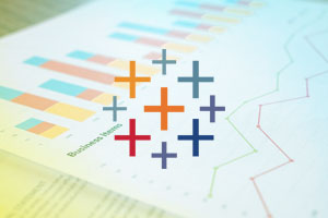 Tableau logo over stock photo of graphs