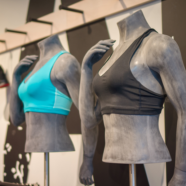 Retail display of mannequins wearing sports clothes
