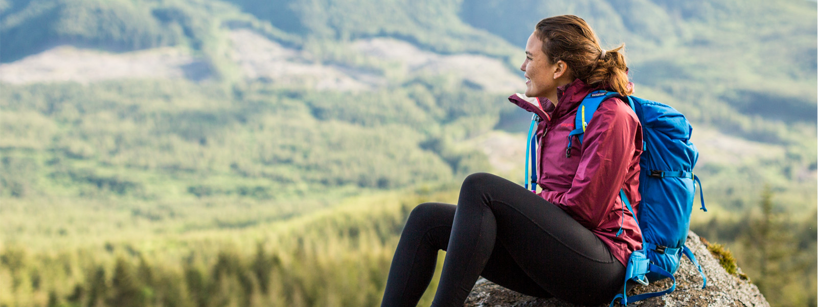 SPM student pauses on a hike to sit on a rock and take in the beautiful scenery of Oregon