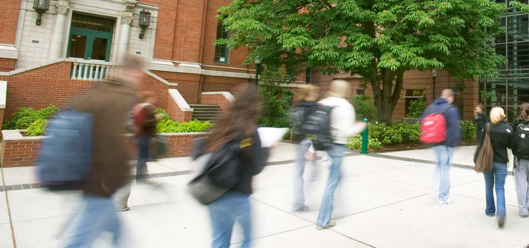 Students walking into the Lillis building