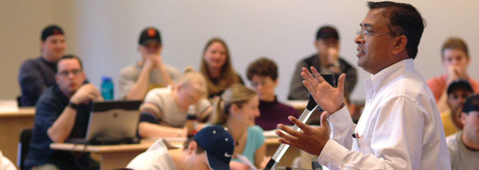 A professor addresses a classroom of students