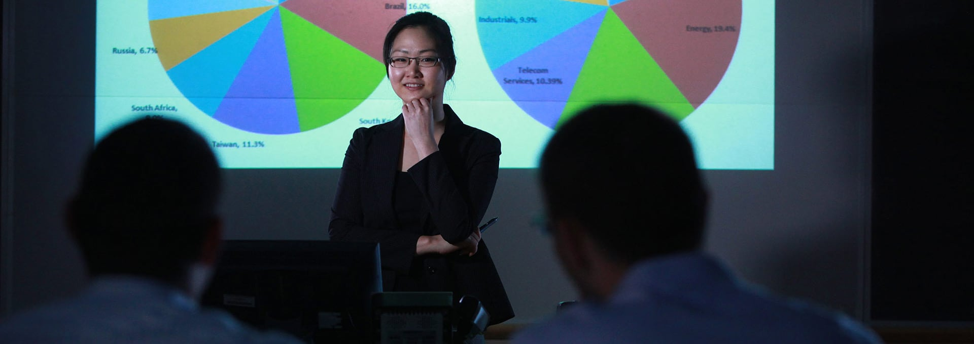 A student makes a presentation before her colleagues