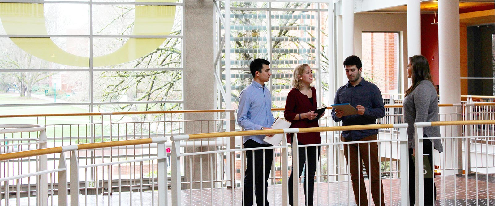 OBCG students talk in the Lillis atrium