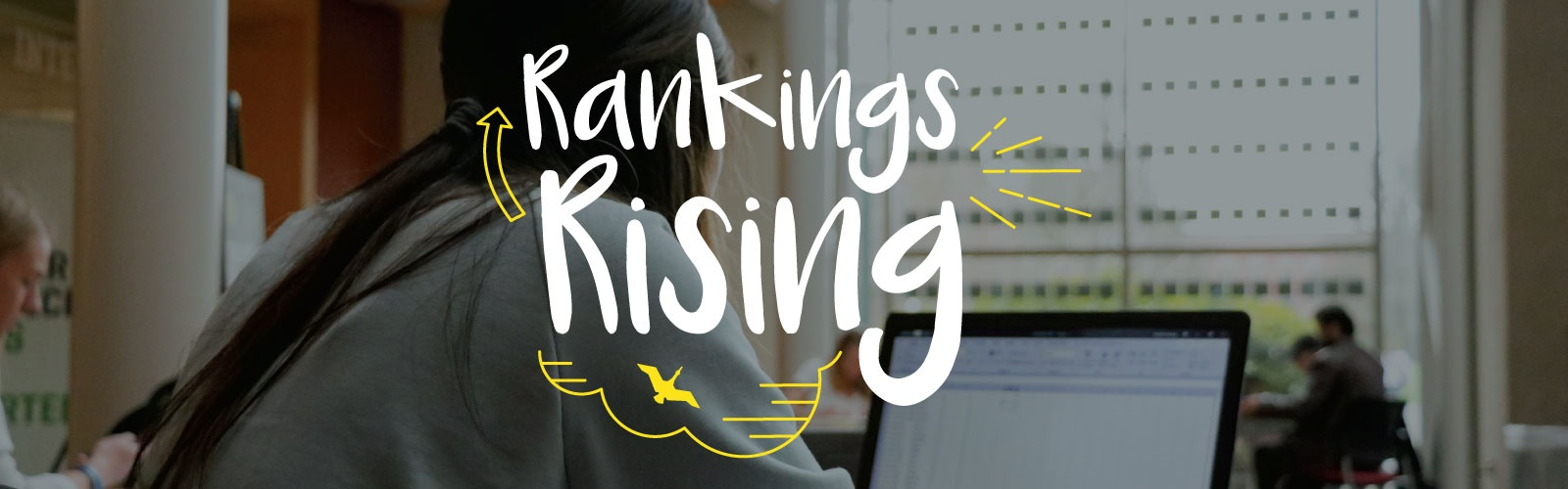 The phrase 'rankings rising' over a photo of a student studying on a laptop