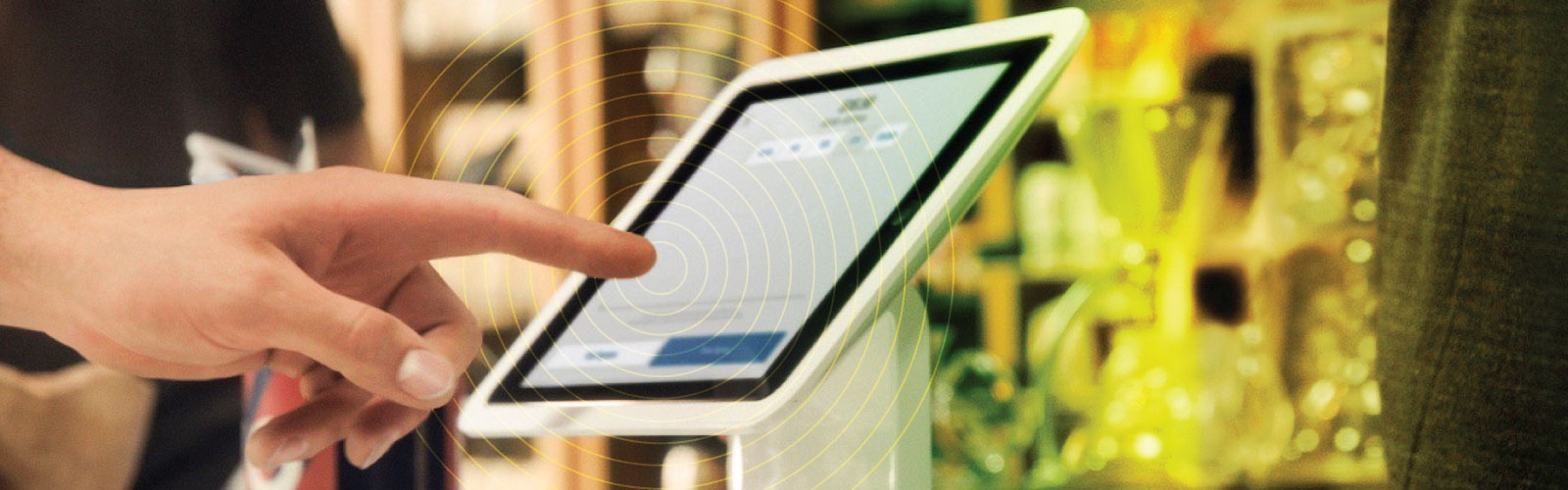 Close up photo of a customer entering information on a point of sale device