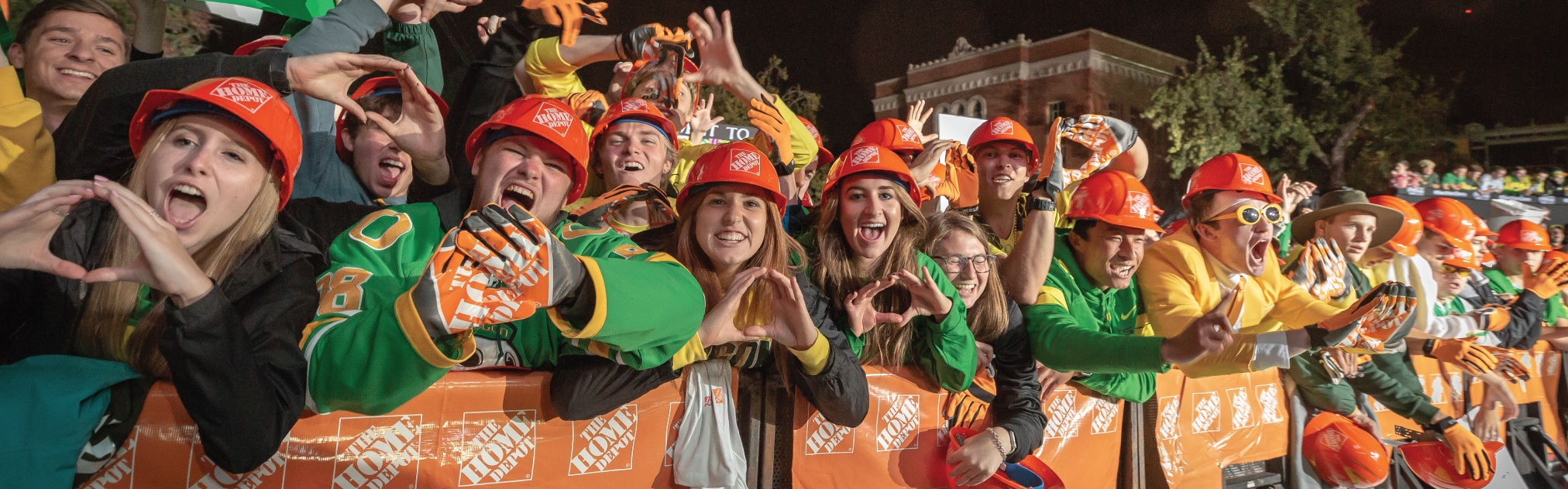 A crowd of students throw the O during College GameDay