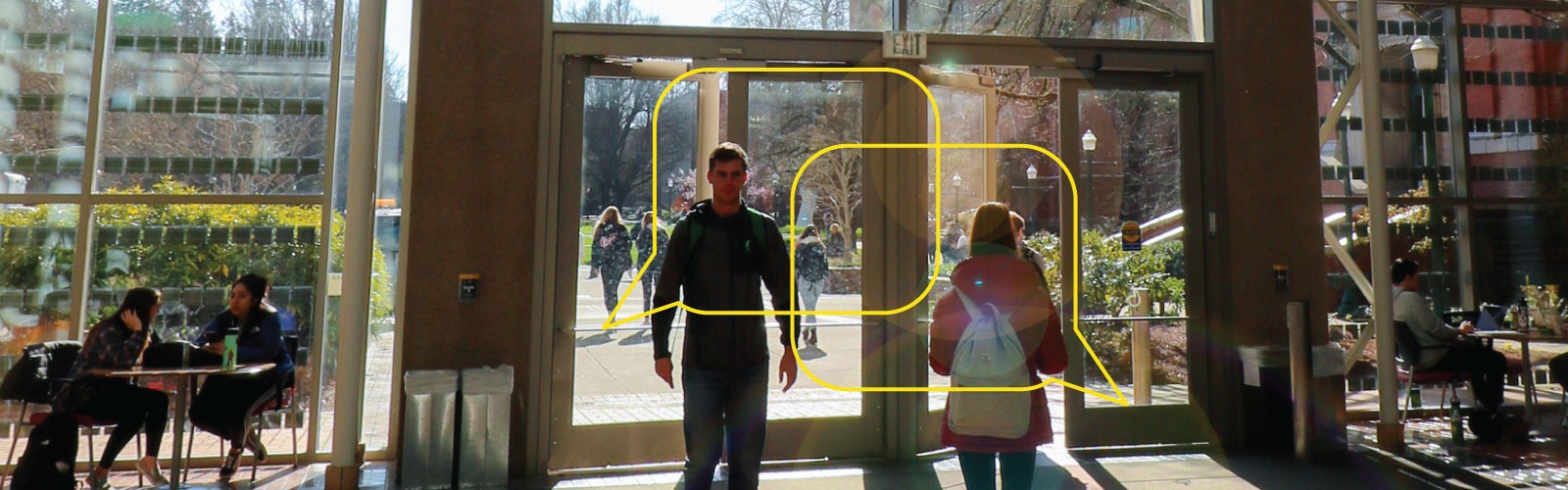 Students entering and exiting the Lillis Business Complex