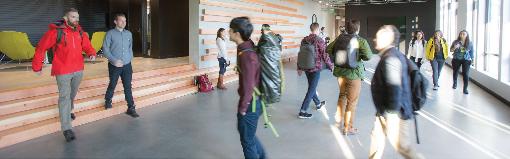 Students walking in the halls of the new Naito building