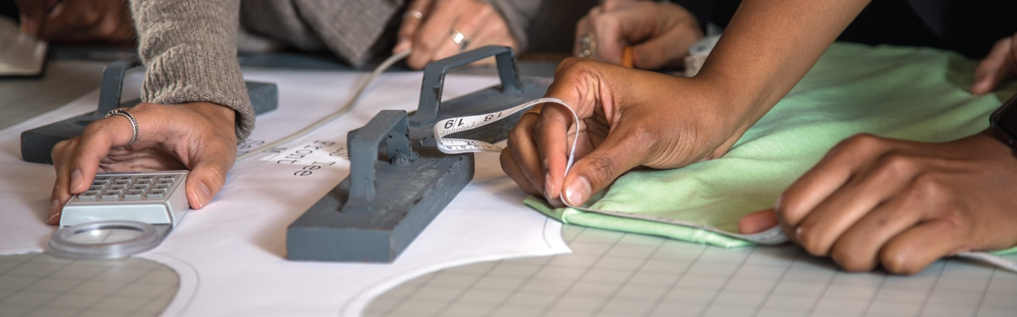 Close up photo of students working on measuring a sports product
