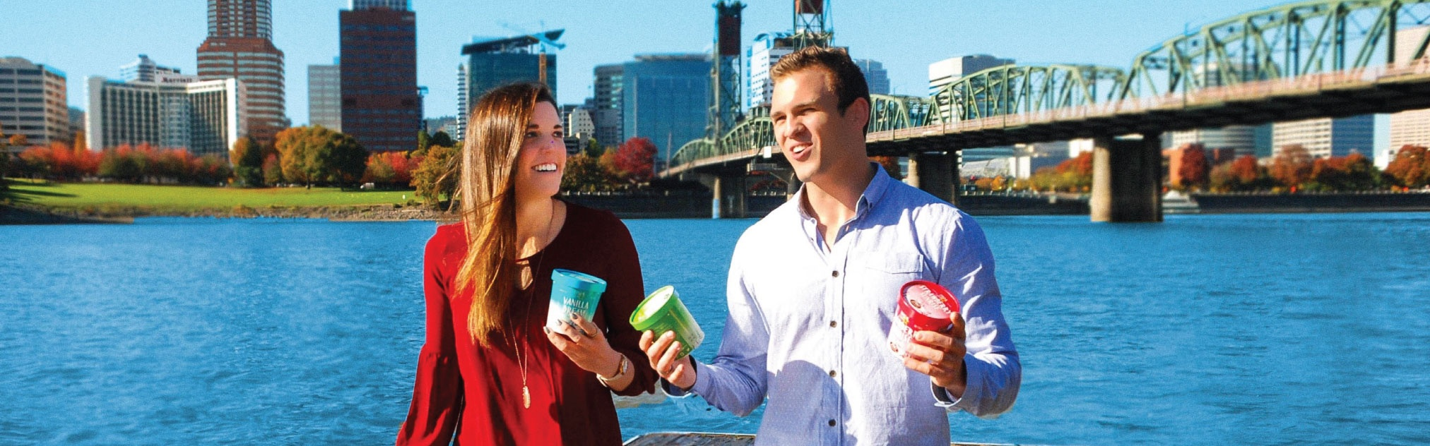 School of Accounting alumni hold their ice cream against a backdrop of Portland cityscape