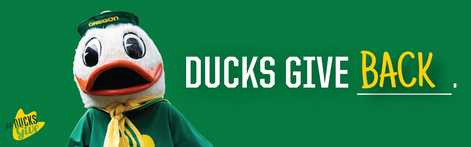 "Photo of the UO Duck next to the words ""Ducks Give Back"""