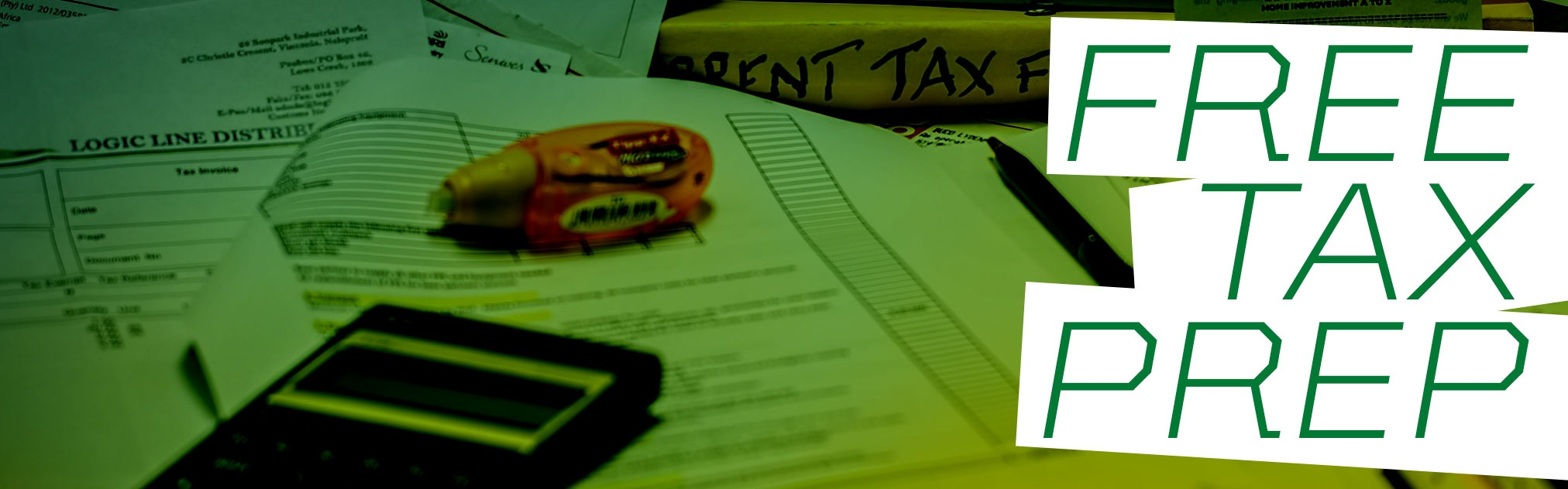 """""""Free Tax Prep"""" against background of tax documents"""