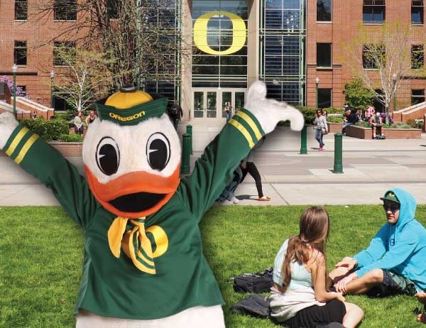 A faux-3D design of the Duck mascot in front of the Lillis Business Complex