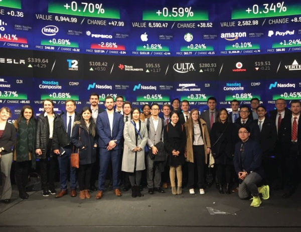 MBA students take a group photo at the stock exchange