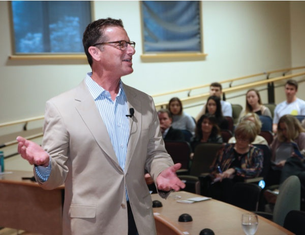 Pape Group CEO Jordan Pape speaks to a student