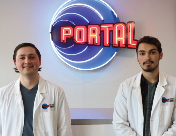 The Tokatly brothers in front of the sign for the Portal Escape Rooms