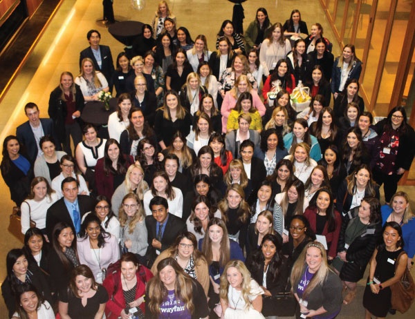 Women in Business club members pose for a photo