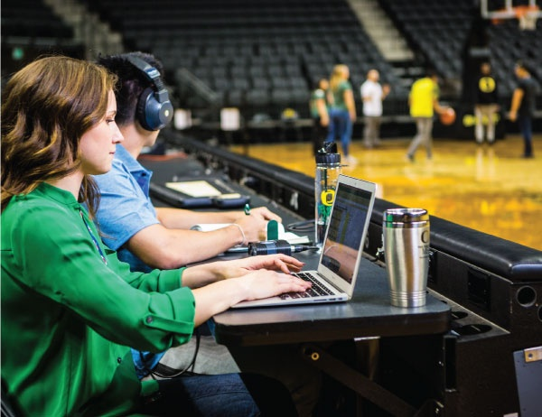 Warsaw Center students take notes during a basketball game