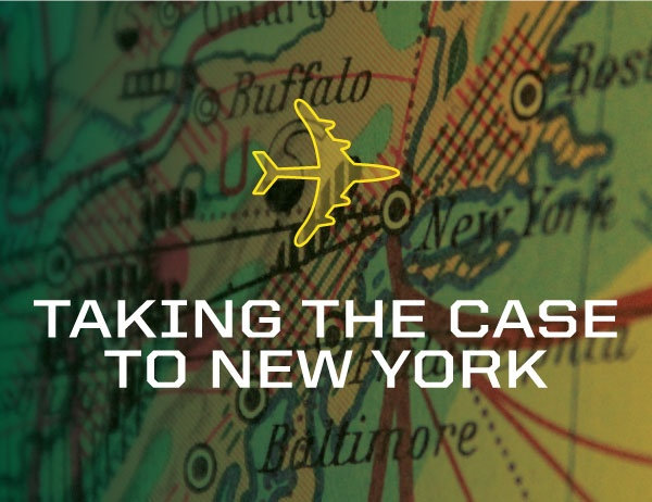 """""""Taking the Case to New York"""" in the foreground of a map"""