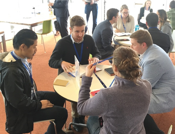 People around a table discuss a project