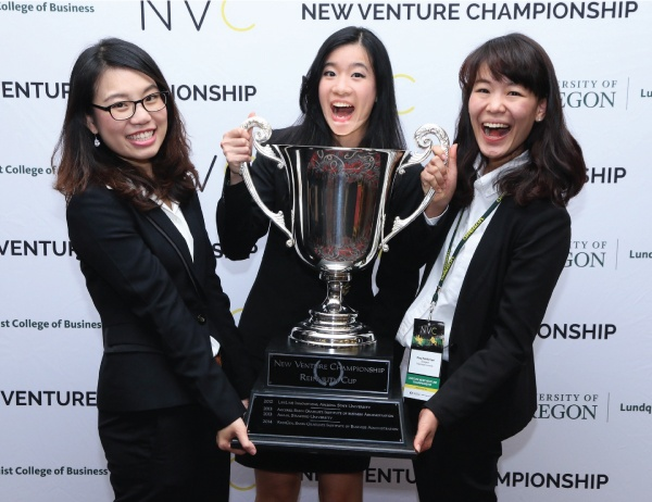 NVC 2015 Grand Prize Winning Team Ecogent in front of NVC Banner with trophy