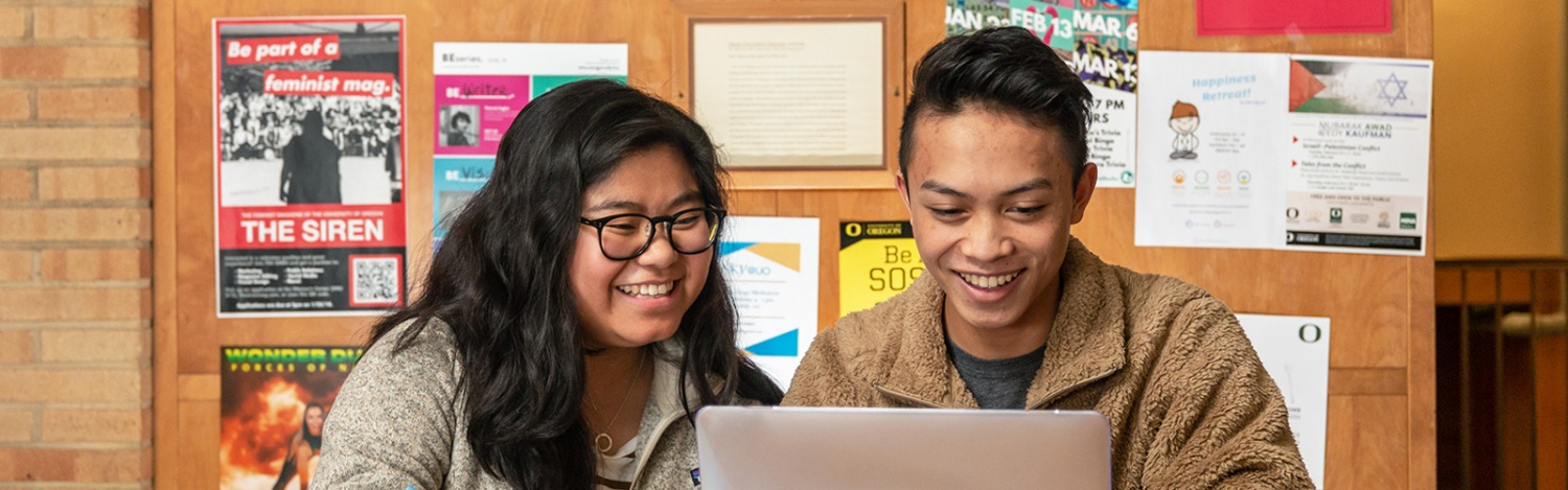 Two students chat together in Earl Hall