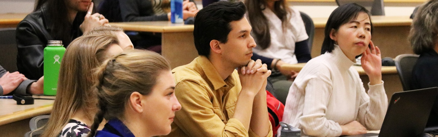 Students listen to a lecture in a classroom
