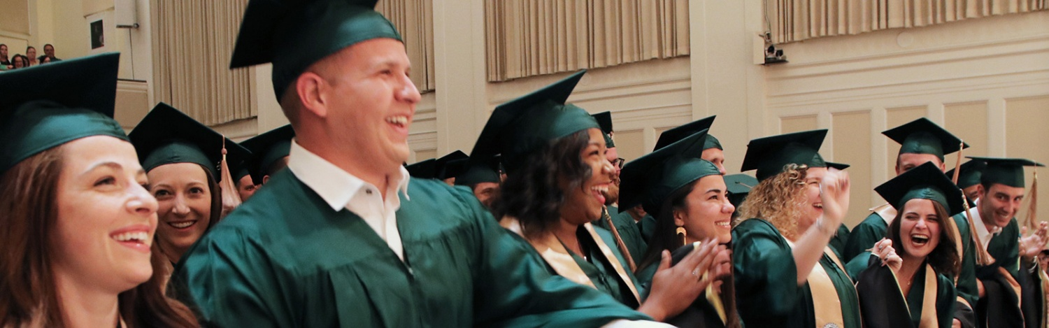MBA graduates cheer during commencement
