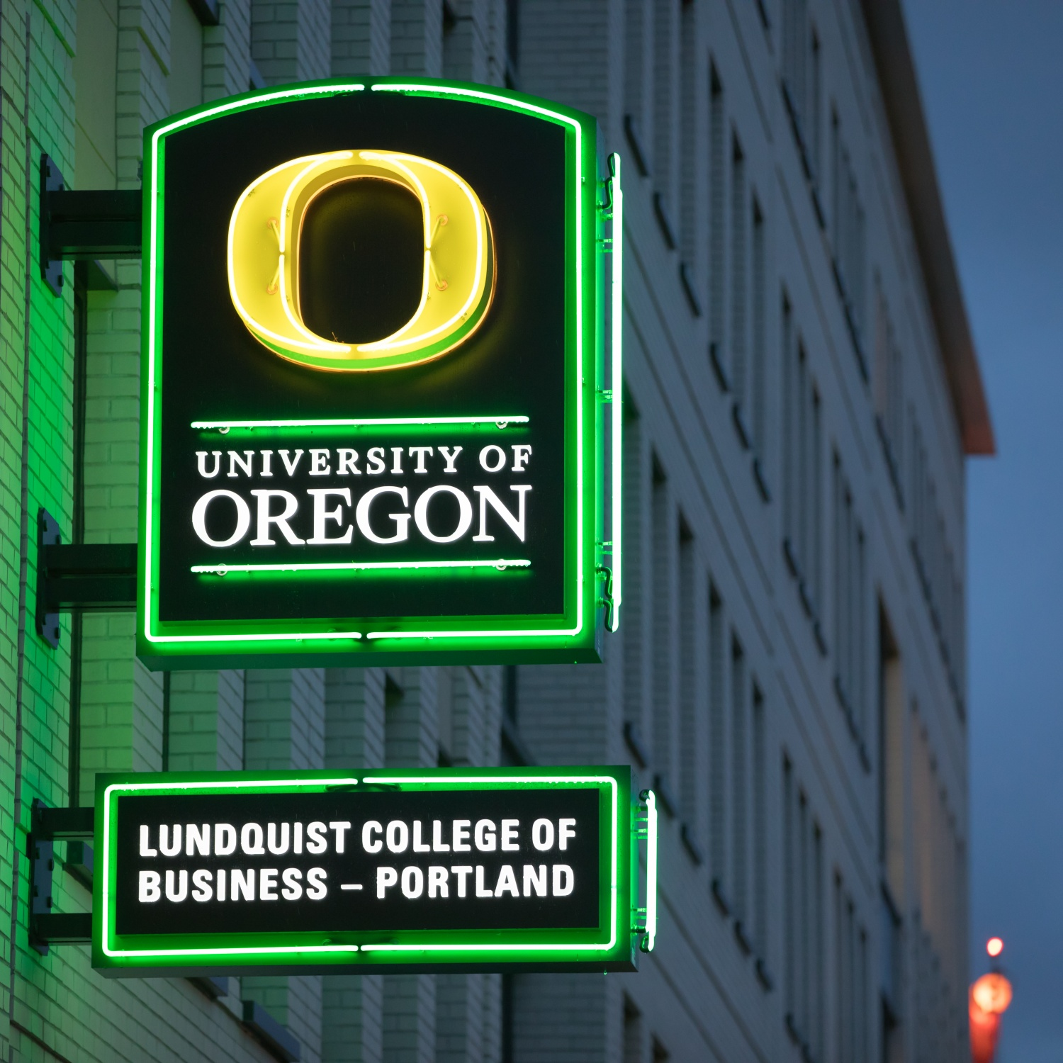 Close up one the Lundquist College of Business Portland neon sign located on the corner of the building near the 109 NW Naito entrance