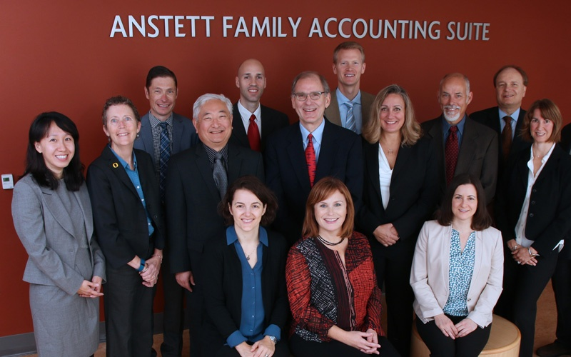 Accounting faculty pose for a group photo in front of the Anstett Accounting Suite in 2017
